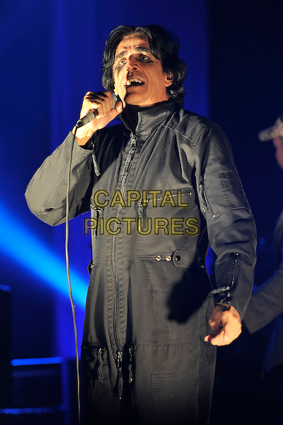 KILLING JOKE - Jaz Coleman.Performing live at the Hammersmith Apollo, London, England..October 16th, 2010.stage concert gig performance music  half length black jumpsuit jacket make-up eyeliner singing .CAP/MAR.© Martin Harris/Capital Pictures.