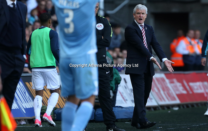 Stoke City manager Mark Hughes shouts instructions at Erik Pieters of Stoke City during the Premier League match between Swansea City and Stoke City at The Liberty Stadium, Swansea, Wales, UK. Saturday 22 April 2017