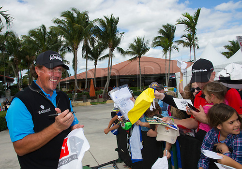28.02.2016. Palm Beach, Florida, USA.  Phil Mickelson smiles while signing autographs for children during the final round of the Honda Classic at the PGA National Resort & Spa in Palm Beach Gardens, FL.