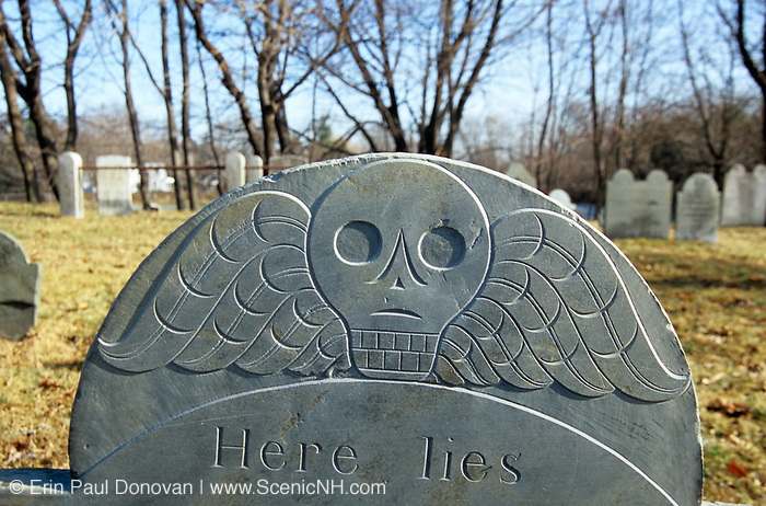 Old skull and wings headstone at South Cemetery in Portsmouth, New Hampshire.