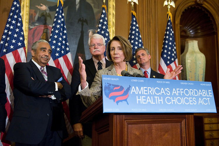 From left, House Ways and Means Committee chairman Charlie Rangel, D-N.Y., House Education and Labor Committee chairman George Miller, D-Calif., Speaker of the House Nancy Pelosi, D-Calif., and Rep. Robert Andrews, D-N.J., participate in a news conference on the House's healthcare reform bill on Friday, July 17, 2009.
