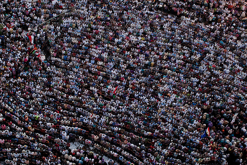 Supporters of Mulsim Brotherhood presidential candidate Mohammed Morsi demonstrate pray in central Cairo's Tahrir Square during a rally in support of the Islamist candidate during the final calculation of votes, June 26, 2012. Photo: Ed Giles.