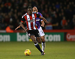 Clayton Donaldson of Sheffield Utd  gets past Darren Pratley of Bolton Wanderers during the Championship match at Bramall Lane Stadium, Sheffield. Picture date 30th December 2017. Picture credit should read: Simon Bellis/Sportimage