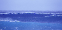 Huge, ominous winter surf rolling in on the North Shore of Oahu