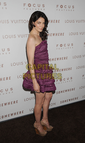 "MICHELLE MONAGHAN .Arriving at the Los Angeles premiere of ""Somewhere"" at ArcLight Cinemas, Hollywood, California, USA, .December 7th, 2010..full length  strapless purple dress ruched side wedges beige patent wooden .CAP/ROT/TM.©Tony Michaels/Roth Stock/Capital Pictures"