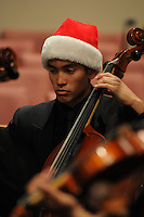 Students perform Monday Dec. 8, 2014 during the Bentonville High School Chamber Orchestra's Winter Christmas concert at the Bella Vista Community Church. Donations are being sought to help support the orchestra with its trip to Orlando, Fla., for the national competition at the Festival of Gold next year.