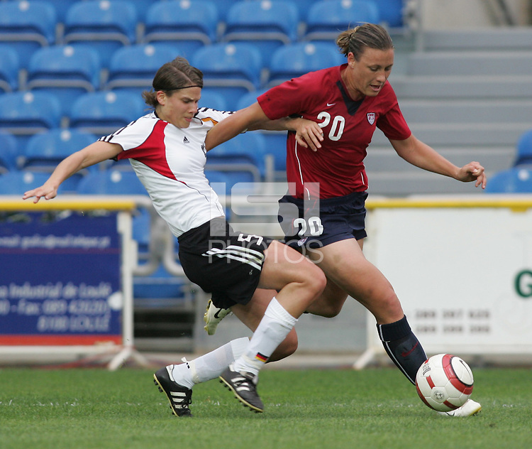 MAR 15, 2006: Faro, Portugal:  USWNT forward (20) Abby Wambach tries to make her way past German defender (5) Annike Krahn in the finals of the Algarve Cup in Faro, Portugal.