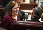 Nevada Senate Republicans Becky Harris and James Settelmeyer work on the Senate floor at the Legislative Building in Carson City, Nev., on Tuesday, April 28, 2015. <br /> Photo by Cathleen Allison