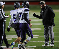 NWA Democrat-Gazette/ANDY SHUPE<br /> Fayetteville coach Daryl Patton speaks to a game official against Har-Ber Saturday, Dec. 5, 2015, during the second half of the Class 7A state championship game at War Memorial Stadium in Little Rock. Visit nwadg.com/photos to see more photographs from the game.
