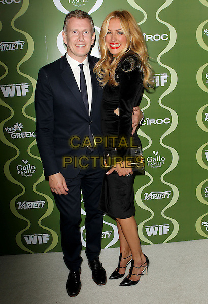Patrick Kielty &amp; Cat Deeley<br /> Variety &amp; Women In Film Pre-Emmy Event presented by Yoplait Greek held at Scarpetta, Beverly Hills, California, USA, <br /> 20th September 2013.<br /> full length black dress suit tie arm around husband wife couple clutch bag cut out <br /> CAP/ADM/KB<br /> &copy;Kevan Brooks/AdMedia/Capital Pictures