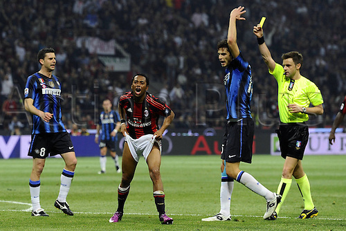 02 04 2011  Series A. AC  Milan versus Inter Milan.  Photo  Robinho pulls up his shorts in fun as Ranocchia Andrea  receives a yellow card from the referee