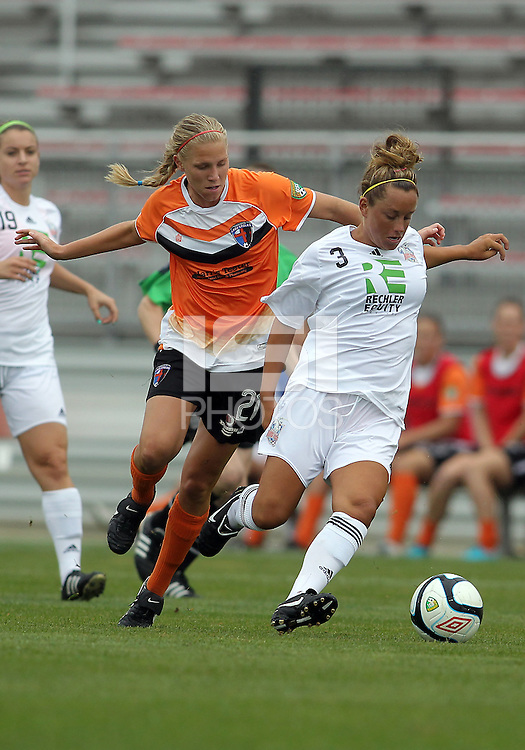 BOYDS, MARYLAND - July 21, 2012:  Samantha Huecker (21) of Charlotte Lady Eagles runs up behind Elyse Tomasello (13) of the Long Island Roughriders during a W League Eastern Conference Championship semi final match at Maryland Soccerplex, in Boyds, Maryland on July 21.