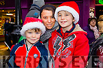 Calvin, Evelyn and Cody O'Sullivan, Tralee, enjoying the atmosphere at the Tralee Christmas Parade on Saturday last.