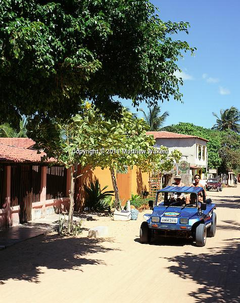 JERICOACOARA, BRAZIL: A dune buggy drives down the sandy back streets of  Jericoacoara, Brazil .