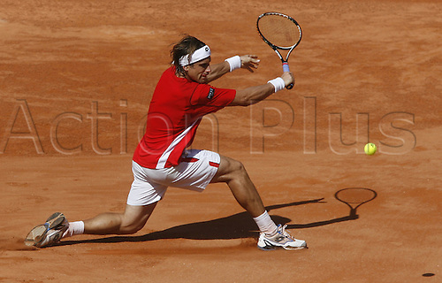 16.09.2011. Cordoba, Spain. Davis Cup tennis match. Spain versus France. David Ferrer returns for Spain in his match