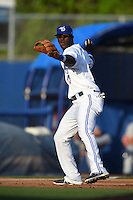Dunedin Blue Jays  third baseman Gustavo Pierre (17) throws to first during a game against the Brevard County Manatees on April 11, 2014 at Florida Auto Exchange Stadium in Dunedin, Florida.  Brevard County defeated Dunedin 5-2.  (Mike Janes/Four Seam Images)