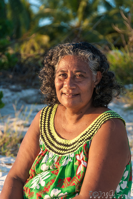 A portrait of a local i-kiribati woman on the beach at sunset on Kiritimati in Kiribati