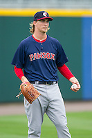 Henry Owens (37) of the Pawtucket Red Sox warms up in the outfield prior to the game against the Charlotte Knights at BB&T Ballpark on August 10, 2014 in Charlotte, North Carolina.  The Red Sox defeated the Knights  6-4.  (Brian Westerholt/Four Seam Images)