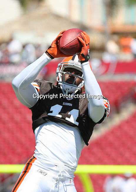 Cleveland Browns wide receiver Mohamed Massaquoi catches a pass during pre-game warm-ups as the Browns played the Buccaneers in the opening NFL regular season game Sunday, Sept. 12, 2010 in Tampa,Fla. (AP Photo/Margaret Bowles)