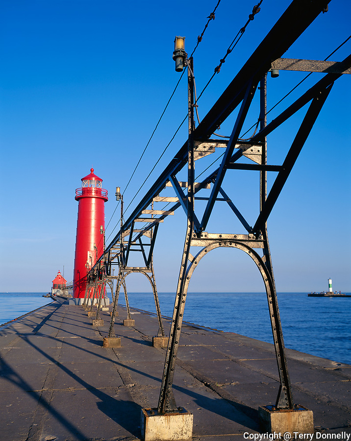 Ottawa County, MI   <br /> Grand Haven South Pier Light (1839) and catwalk in morning sun, lake Michigan