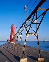 Ottawa County, MI   <br /> Grand Haven South Pier Light (1839) and catwalk in morning sun, lake Michigan
