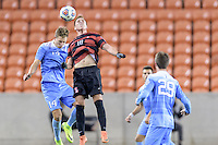Houston, TX - Friday December 9, 2016: Corey Baird (10) of the Stanford Cardinal wins a header over Nils Bruening (14) of the North Carolina Tar Heels at the NCAA Men's Soccer Semifinals at BBVA Compass Stadium in Houston Texas.