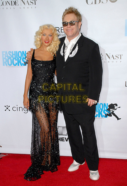 CHRISTINA AGUILERA & SIR ELRON JOHN.Conde Nast Media Group's Third Annual Fashion Rocks Concert at Radio City Music Hall, New York, NY, USA,.7 September 2006..full length arm around shoulder sunglasses black beaded dress sheer see through.Ref: ADM/PH.www.capitalpictures.com.sales@capitalpictures.com.©Paul Hawthorne/AdMedia/Capital Pictures. *** Local Caption ***