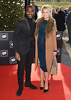 Ore Oduba and wife, Portia<br /> arriving for the TRIC Christmas Party, Grosvenor House Hotel, London.<br /> <br /> <br /> &copy;Ash Knotek  D3362  12/12/2017