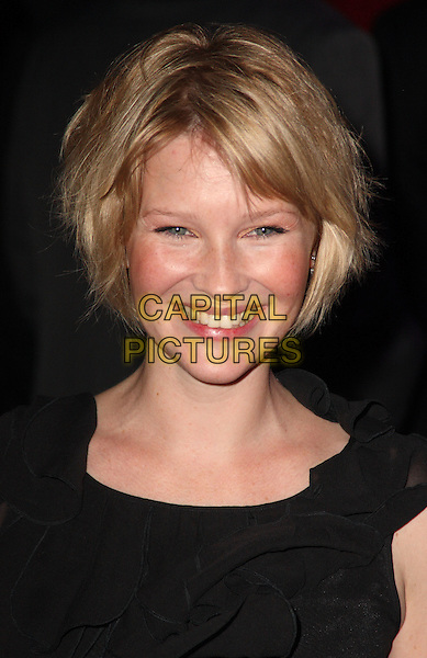 "JOANNA PAGE .Attending the UK film premiere of ""The Imaginarium Of Doctor Parnassus"" at the Empire Leicester Square cinema, London, England, UK, October 6th 2009..portrait headshot black smiling blusher bronzer make-up .CAP/JIL.©Jill Mayhew/Capital Pictures"