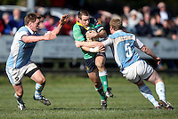 Ballynahinch out half Ryan Bambry on the attack is tackled by Frank McKenna during the AIB Cup semi-final against Garryowen at Ballymacarn Park, Ballynahinch. Mandatory Credit - John Dickson