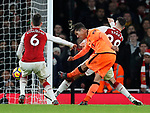 Liverpool's Roberto Firmino scoring his sides third goal during the premier league match at the Emirates Stadium, London. Picture date 22nd December 2017. Picture credit should read: David Klein/Sportimage