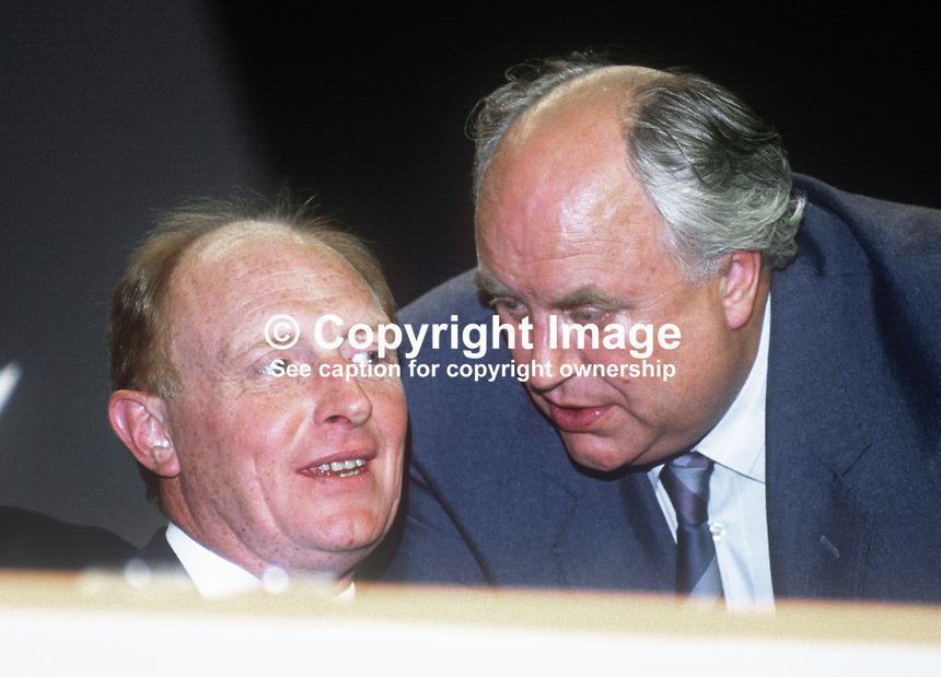 A word in your ear! Norman Willis, general secretary, Trades Union Congress, chatting to UK Labour Party leader Neil Kinnock, on the platform at the TUC's annual conference, September 1986. 19860901NK9<br /> <br /> Copyright Image from Victor Patterson, 54 Dorchester Park, <br /> Belfast, UK, BT9 6RJ<br /> <br /> t1: +44 28 9066 1296 (from Rep of Ireland 048 9066 1296)<br /> t2: +44 28 9002 2446 (from Rep of Ireland 048 9002 2446)<br /> m: +44 7802 353836<br /> <br /> e1: victorpatterson@me.com<br /> e2: victorpatterson@gmail.com<br /> www.victorpatterson.com<br /> <br /> Please see my Terms and Conditions of Use at www.victorpatterson.com. It is IMPORTANT that you familiarise yourself with them.<br /> <br /> Images used on the Internet must be visibly watermarked i.e. &copy; Victor Patterson<br /> within the body of the image and copyright metadata must not be deleted. Images <br /> used on the Internet have a size restriction of 4kbs and will be chargeable at current<br />  NUJ rates unless agreed otherwise.<br /> <br /> This image is only available for the use of the download recipient i.e. television station, newspaper, magazine, book publisher, etc, and must not be passed on to any third <br /> party. It is also downloaded on condition that each and every usage is notified within 7 days to victorpatterson@me.com<br /> <br /> The right of Victor Patterson to be identified as the author is asserted in accordance with The Copyright Designs And Patents Act (1988). All moral rights are asserted.