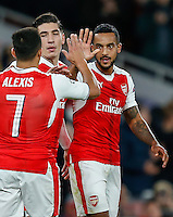 Theo Walcott of Arsenal (right) celebrates scoring his goal to make it 2-0 with Alexis Sanchez of Arsenal (left) during the UEFA Champions League match between Arsenal and PFC Ludogorets Razgrad at the Emirates Stadium, London, England on 19 October 2016. Photo by David Horn / PRiME Media Images.