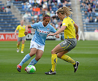 Chicago forward Casey Nogueira (27) makes a move against Philadelphia defender Allison Falk (3).  The Philadelphia Independence defeated the Chicago Red Stars 1-0 at Toyota Park in Bridgeview, IL on May 15, 2010.