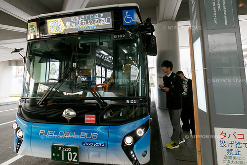 People enter a hydrogen fuel cell bus at Tokyo Big Sight on March 23, 2017, Tokyo, Japan. From March 21, the Tokyo Metropolitan Government Bureau of Transportation has been operating two hydrogen fuel cell buses on the route between Tokyo Station and the International Exhibition Center (Tokyo Big Sight). The new public transports, developed by Toyota Motor Corporation, are part of the bureau plan to contribute to a ''hydrogen society''. (Photo by Rodrigo Reyes Marin/AFLO)