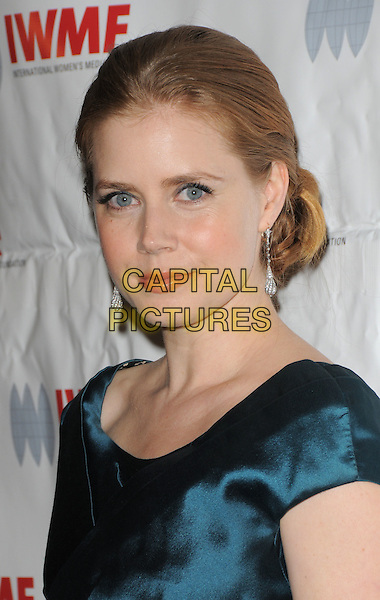 AMY ADAMS.The International Women's Media Foundation's Courage in Journalism Awards held at The Beverly Hills Hotel in Beverly Hills, California, USA. .October 16th, 2008                                                                     .headshot portrait green blue teal .CAP/DVS.©Debbie VanStory/Capital Pictures.