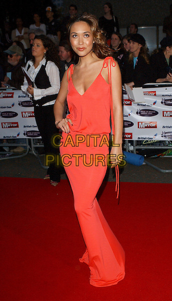 MYLEENE KLASS .The Daily Mirror's Pride of Britain Awards at the ITV Centre, London Studios, London, UK..October 10th, 2005.Ref: BEL.full length red dress bows plunging neckline.www.capitalpictures.com.sales@capitalpictures.com.© Capital Pictures.