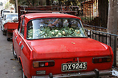 Sofia, Bulgaria. Back of an old red car full of cauliflower.