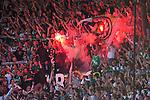 Stockholm 2013-06-23 Fotboll Superettan , Hammarby IF - &Auml;ngelholms FF :  <br /> Hammarby Bajen fans p&aring; Norra l&auml;ktaren med bengaliska eldar under den sista matchen p&aring; S&ouml;derstadion<br /> (Foto: Kenta J&ouml;nsson) Nyckelord:  supporter fans publik supporters bengaler
