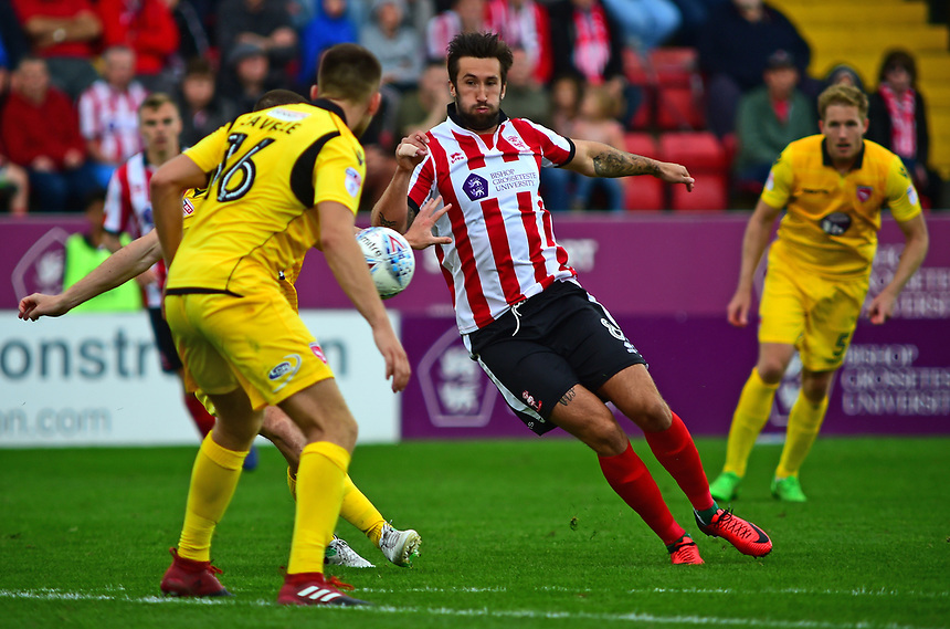 Lincoln City's Ollie Palmer vies for possession with Morecambe's Sam Lavelle<br /> <br /> Photographer Andrew Vaughan/CameraSport<br /> <br /> The EFL Sky Bet League Two - Lincoln City v Morecambe - Saturday August 12th 2017 - Sincil Bank - Lincoln<br /> <br /> World Copyright &copy; 2017 CameraSport. All rights reserved. 43 Linden Ave. Countesthorpe. Leicester. England. LE8 5PG - Tel: +44 (0) 116 277 4147 - admin@camerasport.com - www.camerasport.com
