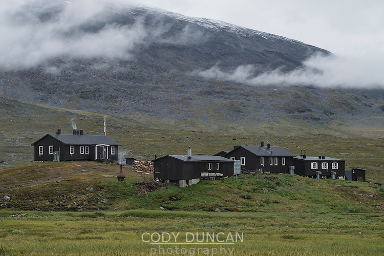 STF Sälka mountan hut surrounded by misty mountains in autumn, Kungsleden Trail, Lapland, Sweden