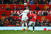 Martin Olsson of Swansea City competes with Jesse Lingard of Manchester United during the Premier League match between Manchester United and Swansea City at the Old Trafford, Manchester, England, UK. Saturday 31 March 2018