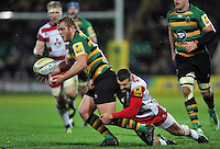 Mike Haywood of Northampton Saints is tackled by Jonny May of Gloucester Rugby. Aviva Premiership match, between Northampton Saints and Gloucester Rugby on November 27, 2015 at Franklin's Gardens in Northampton, England. Photo by: Patrick Khachfe / JMP