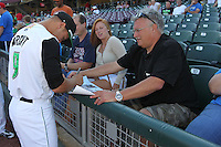 Dayton Dragons second baseman Ryan Wright #9 signs autographs prior to the game against the Lake County Captains at Fifth Third Field on June 25, 2012 in Dayton, Ohio. Lake County defeated Dayton 8-3. (Brace Hemmelgarn/Four Seam Images)
