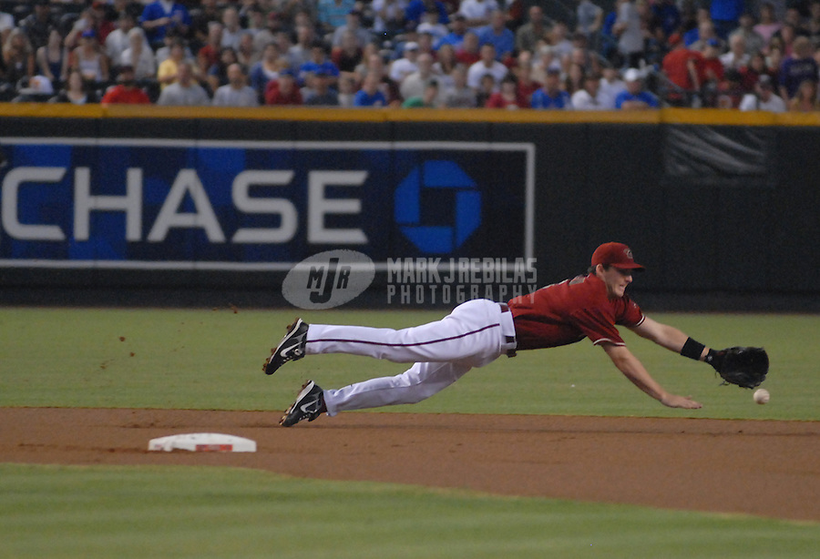Aug 26, 2007; Phoenix, AZ, USA; Arizona Diamondbacks shortstop (6) Stephen Drew dives for ball in the first inning against the Chicago Cubs at Chase Field. Mandatory Credit: Mark J. Rebilas-US PRESSWIRE