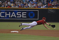 Aug 26, 2007; Phoenix, AZ, USA; Arizona Diamondbacks shortstop (6) Stephen Drew dives for ball in the first inning against the Chicago Cubs at Chase Field. Mandatory Credit: Mark J. Rebilas-US PRESSWIRE