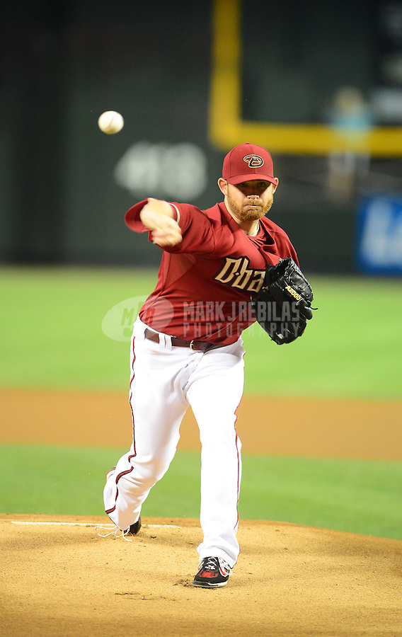 Apr. 22, 2012; Phoenix, AZ, USA; Arizona Diamondbacks pitcher Ian Kennedy throws in the first inning against the Atlanta Braves at Chase Field. Mandatory Credit: Mark J. Rebilas-