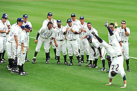 2 May 2010:  FIU's Jeremy Patton (22), cheered on by his teammates, performs a somersault as part of FIU's pre-game ritual.  The University of Louisiana-Monroe Warhawks defeated the FIU Golden Panthers, 8-7 in 11 innings, at University Park Stadium in Miami, Florida.