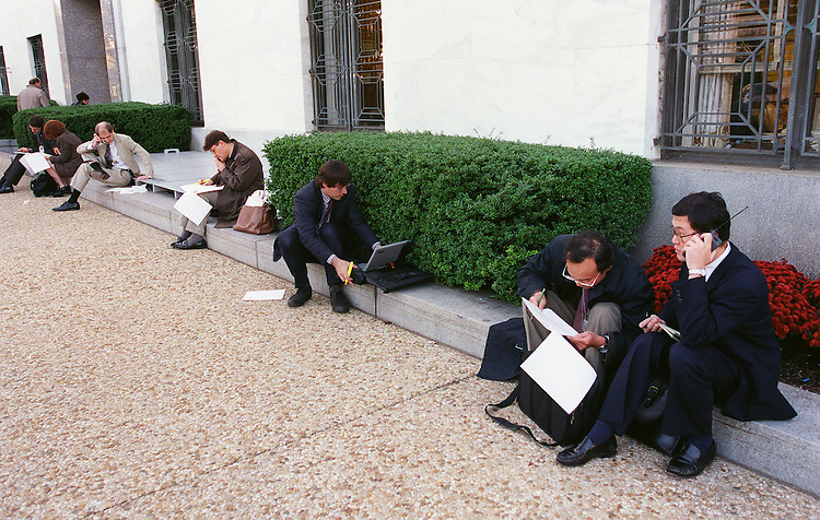 10/29/97.MEDIA--Reporters file stories via cell phone and laptop outside the Dirksen Senate Office Building..CONGRESSIONAL QUARTERLY PHOTO BY SCOTT J. FERRELL