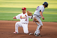 Kolten Wong (4) of the Springfield Cardinals tries to apply a tag at second during a game against the Arkansas Travelers at Hammons Field on June 13, 2012 in Springfield, Missouri. (David Welker/Four Seam Images)